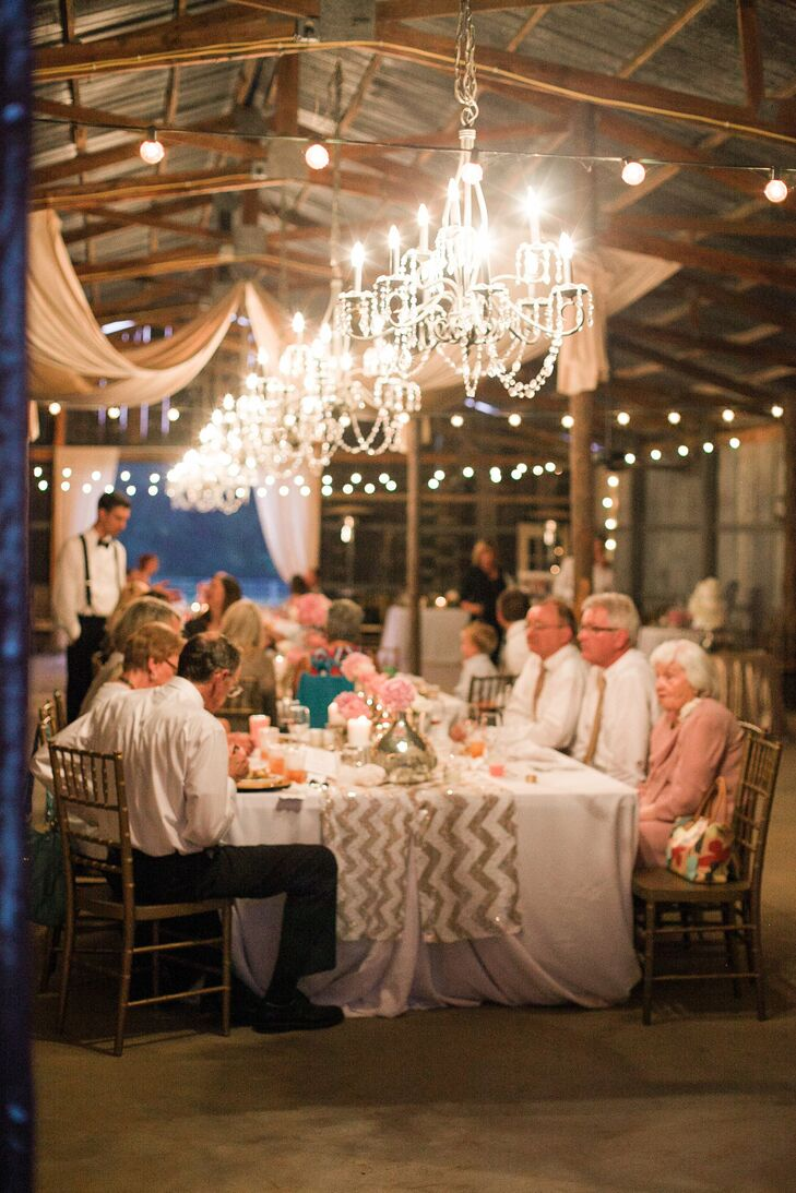 """I run a teen fashion and celebrity magazine entitled Glitter, so that was the inspiration,"" Nikki says. The barn was decorated with large chandeliers, string lights and white drapery."