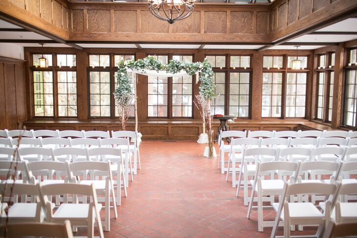 "The day began with an interfaith ceremony in the Willowdale Estate's conservatory. The wood-paneled walls brought a warm, cozy feel to the space, while bright skylights and windows looking out onto the snow-dusted property gave guests a sense of being in the great outdoors. ""It was beautiful at dusk on a wintry evening,"" says Edith."