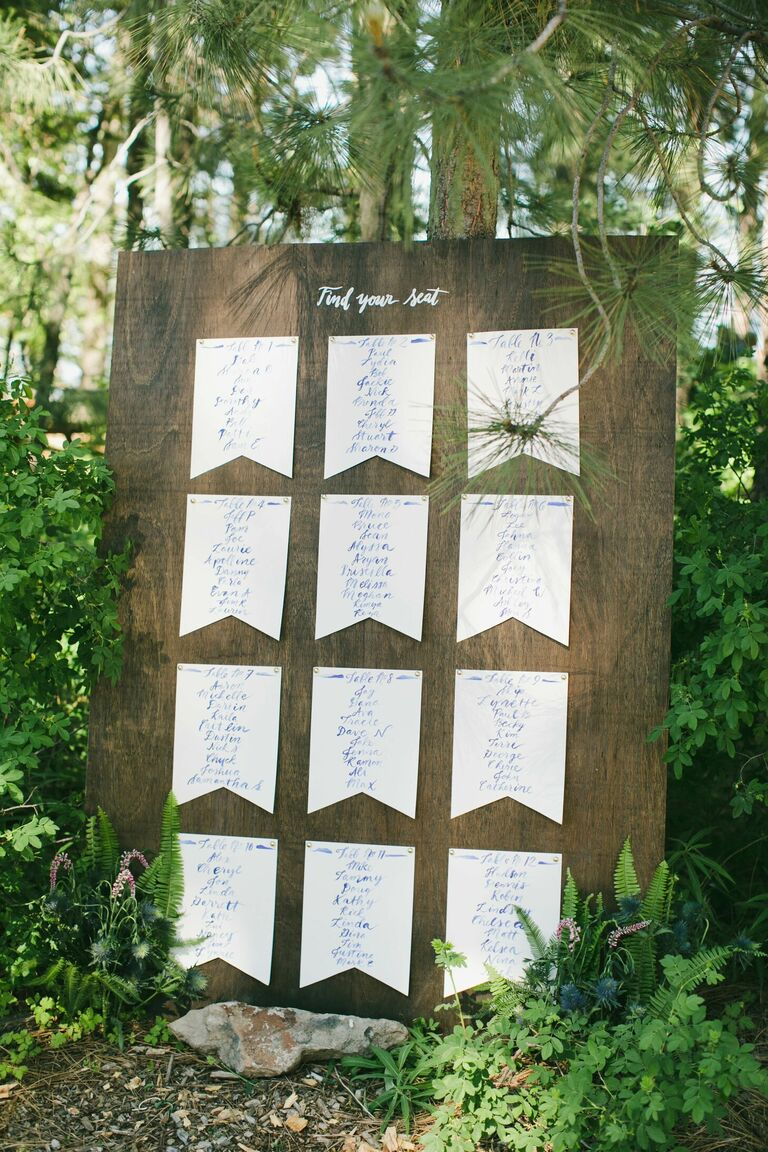 Rustic wood seating chart with pennant-inspired stationery