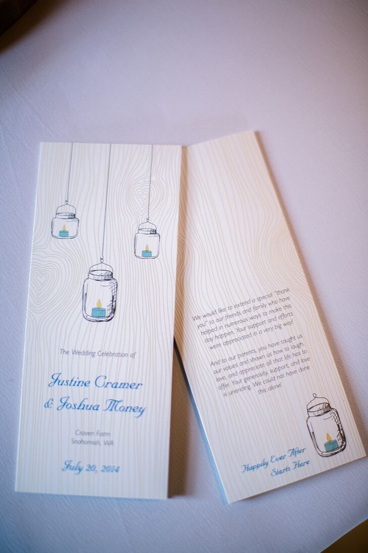 The ceremony programs were etched into wood panels with hanging mason jar designs.