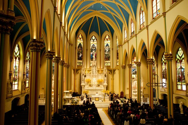 Wanting a traditional Catholic ceremony, Marielle and Roderick chose to host their ceremony at St. Monica's Church, which offered ample space for all of their guests, as well as breathtaking architecture.
