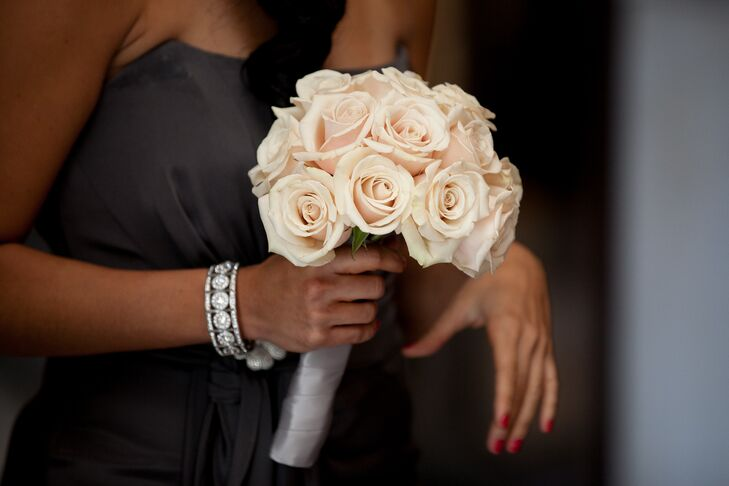 The bridesmaids carried simple, classic bouquets of blush roses, which popped against their charcoal gowns.