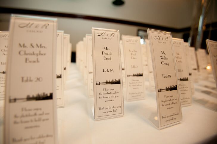 As nod to their wedding's locale, Marielle and Roderick incorporated the Manhattan skyline into the design of their escort cards. The escort cards also doubled as favors, the frames could be used to hold photos guests took at the reception's photo booth.