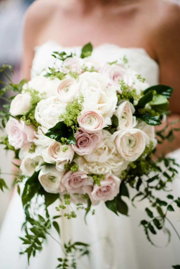 Kate carried a cascading bouquet of white peonies, blush ranunculus, soft garden roses and green foliage.
