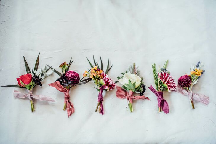 Vibrant Varying Boutonnieres with Pink Ribbon