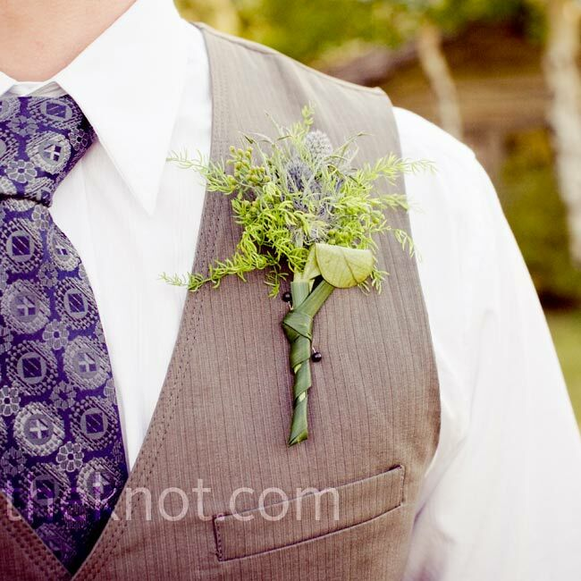 Keeping with the rustic wildflower look, the guys wore thistle and greenery on their lapels.