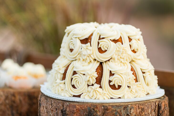 Two tier bundt cake with decorative buttercream frosting