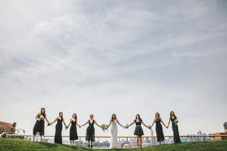 "Bridesmaids wore black dresses in a variety of styles. ""The only instruction I gave them was to choose something black that they felt beautiful in,"" Amanda says. ""This gave them the option to buy a new dress that they could wear again or save money and wear something they already had in their closet."""