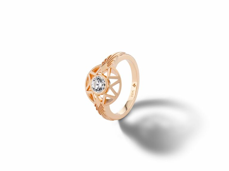 rose gold diamond engagement ring with star halo