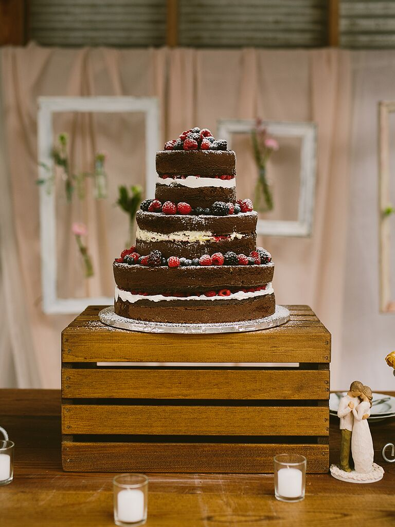Whimsical wooden crate cake stand for a wedding reception
