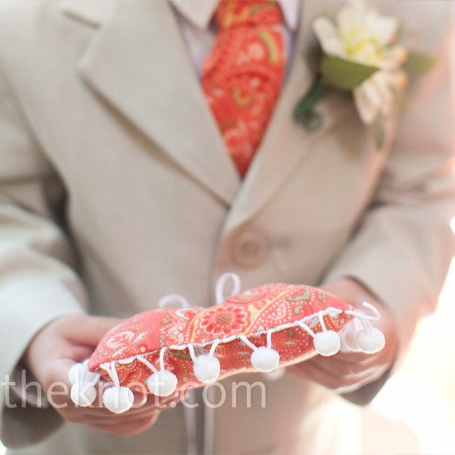 The ring bearer coordinated with a custom-made paisley tie and ring pillow to match.