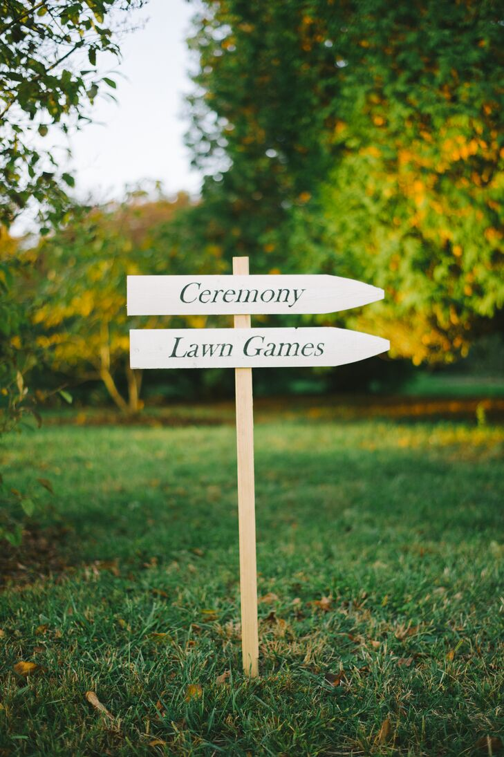 White and Black Wooden Ceremony Sign
