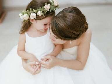 bride and flower girl wearing flower crown