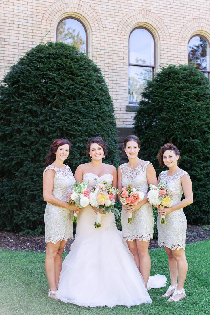 The bridesmaids wore champagne cocktail dresses with a metallic lace overlay.