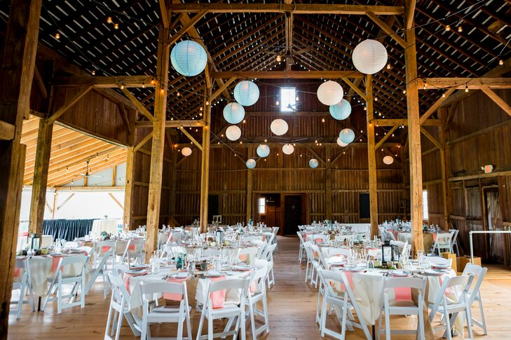 A dusty blue, peach, ivory and pale pink palette dressed up the on-site barn, where guests danced under pastel paper lanterns strung from the rafters.