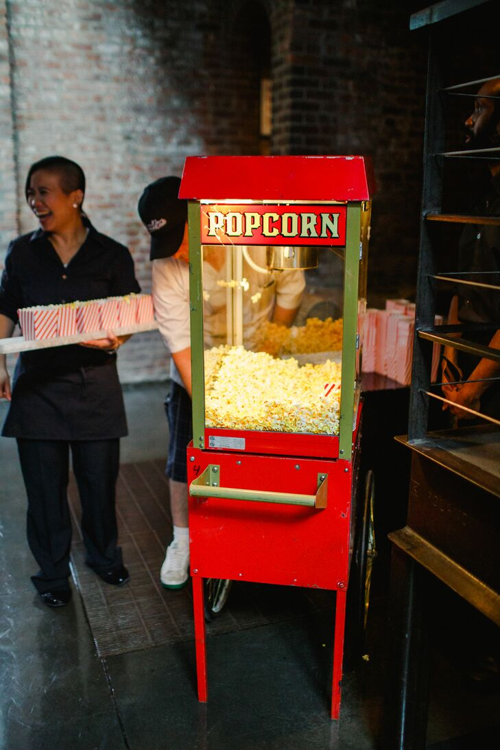 """Fun food in fancy clothes"" was the theme Risa and Michael presented to caterer Betty Brooklyn. ""We wanted a formal party, but with many of the fun foods and snacks we enjoy eating in our real life, with a floating-style dinner rather than seated,"" Risa says. Since Risa loves movie popcorn, the iconic cinema snack made an appearance during the reception, with guests being greeted by a popcorn machine as they entered the Foundry in Long Island City, New York. Betty Brooklyn brought the couple's culinary vision to life with a slew of stations serving everything from sliders to pasta and vegetarian eats and an assortment of comfort food-inspired passed appetizers, including fried chicken biscuits, curly fries and veggie kebabs. ""Betty Brooklyn's food is so special, so delicious and so unlike a meal you've typically been served at a wedding,"" Risa says. ""We were really excited for our guests to enjoy her cuisine."""