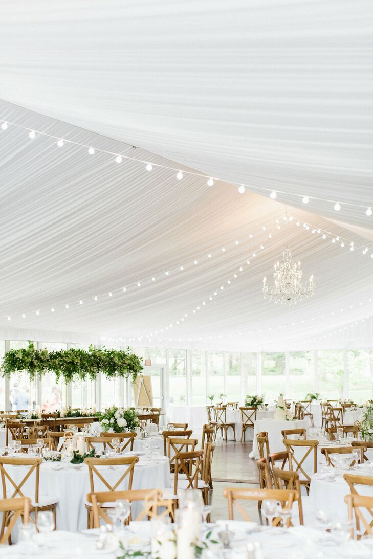 Elegant Reception with White Draping, String Lights and Greenery