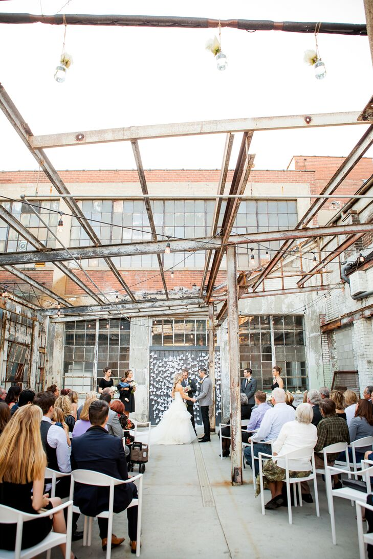 """We had our wedding at the Strongwater venue in Columbus, Ohio, which is an old factory turned studio artist space, bar/restaurant and venue; it has an industrial feel with a modern twist,"" says Kim."