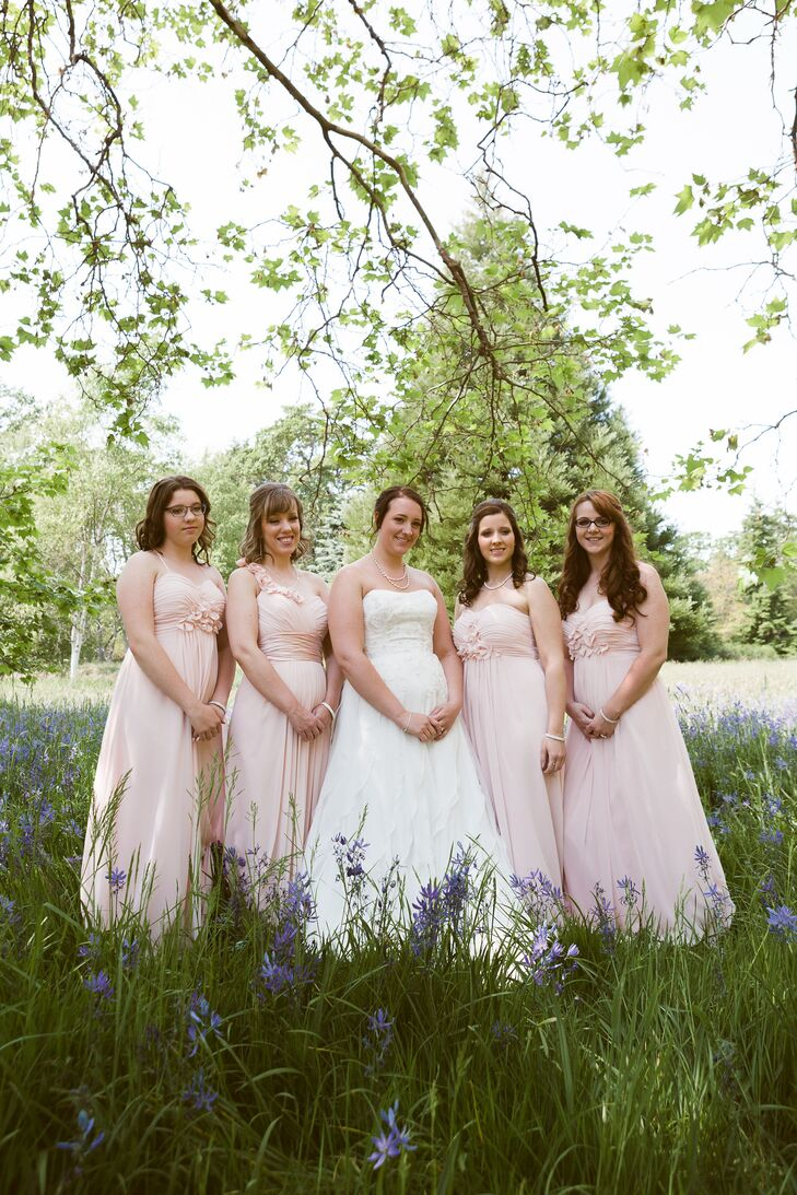 The bridesmaids wore strapless, floor-length, petal pink Bill Levkoff dresses, fitting in with the white and pink wedding's palette.