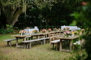 Backyard Reception with Wooden Picnic Tables and Benches