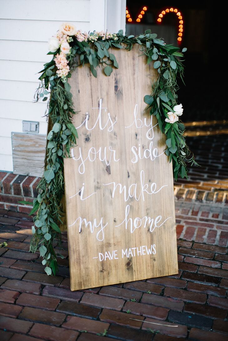 To create a cohesive feel from start to finish, wooden signs bearing the same whimsical calligraphy found on the couple's stationery was woven throughout the day. Draped in garlands of eucalyptus, the signs guided guests to each event and displayed meaningful quotes and lyrics from Hope and Nick's favorite songs.
