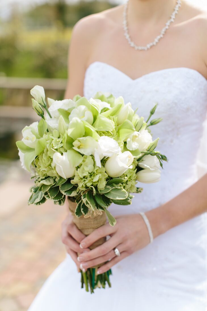She's My Florist designed a gorgeous green and white bouquet of tulips, hydrangeas, roses, lisianthus and cymbidium orchids.