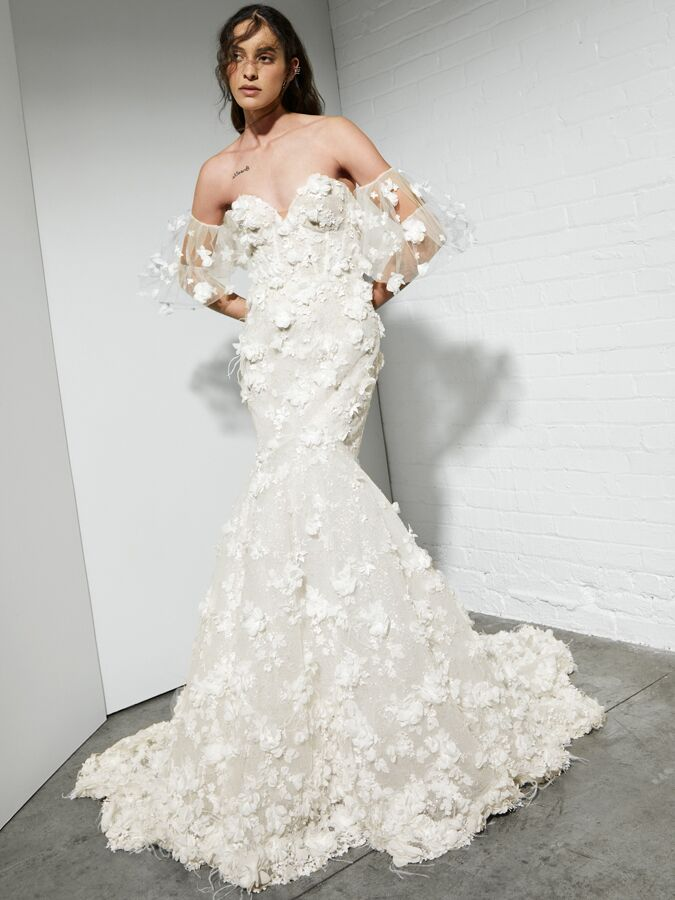 Rivini fit-and-flare wedding dress with large 3D flowers and feathers