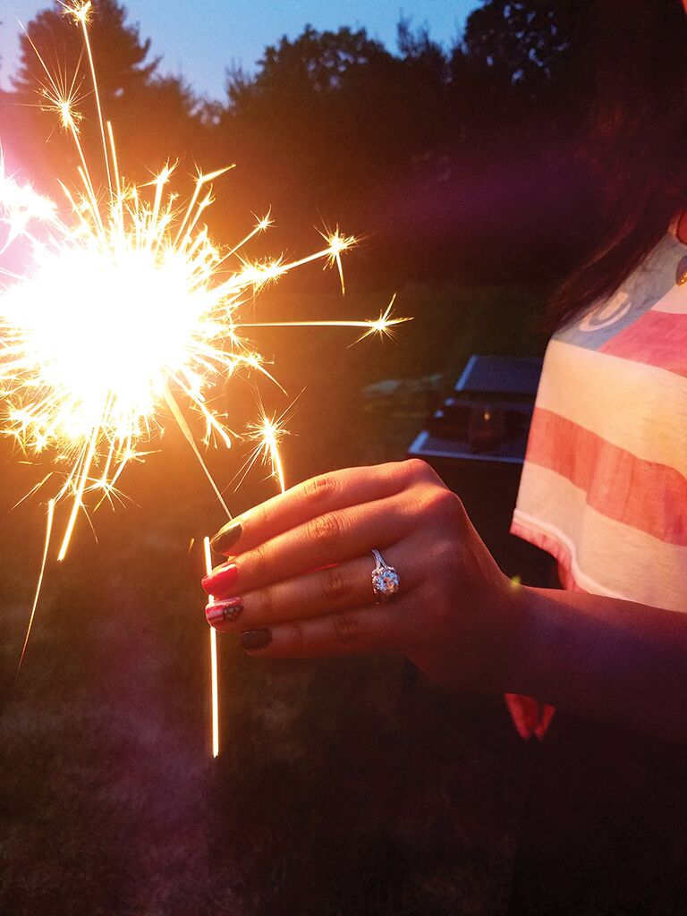 Engagement ring selfie idea with 4th of July sparklers