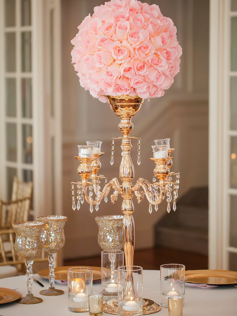 Glamorous crystal and rose gold wedding centerpiece with roses