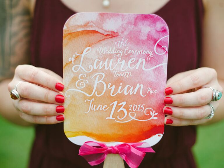 Watercolor ceremony programs with white caligraphy
