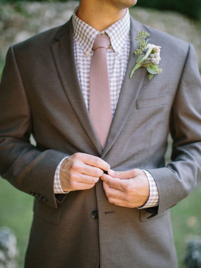 Man in a gray suit with a purple gingham shirt and a pale pink tie