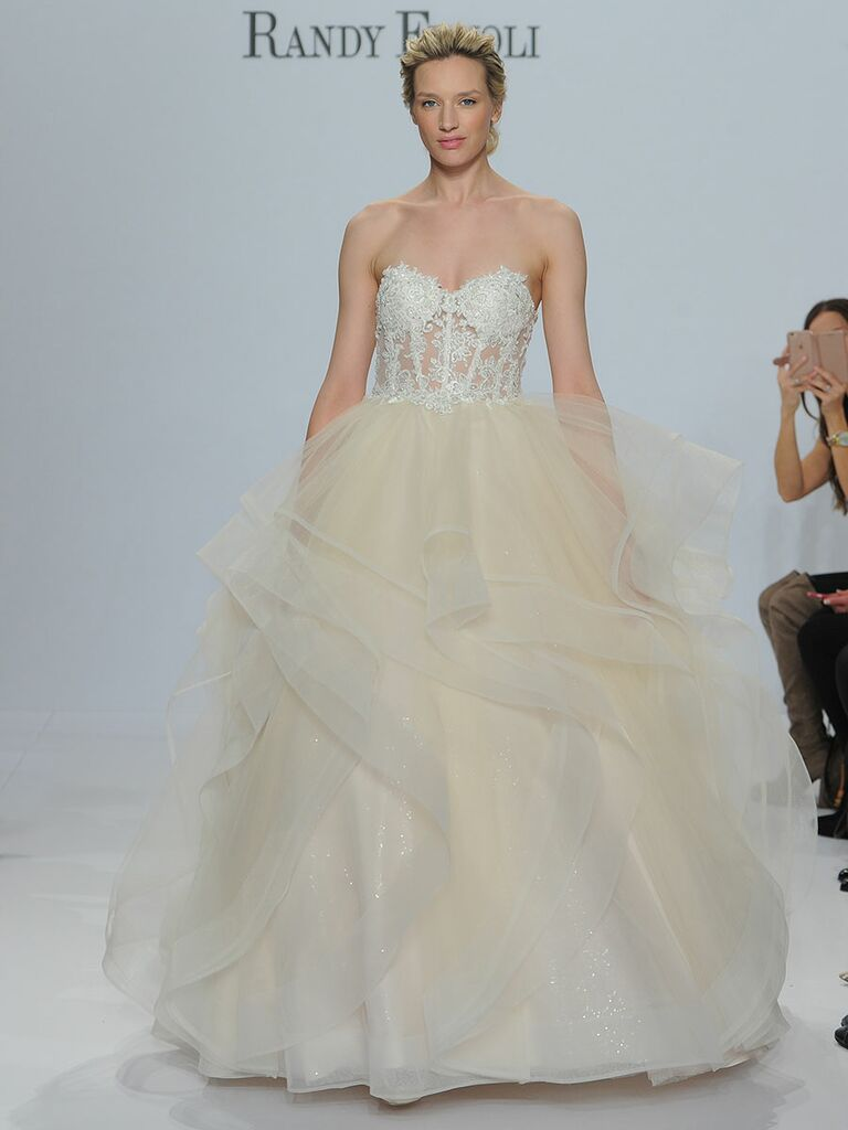 Randy Fenoli Spring 2018 strapless ball gown with sheer sparkling beaded lace voice and ruffled tulle skirt with horsehair trim over sequined tulle