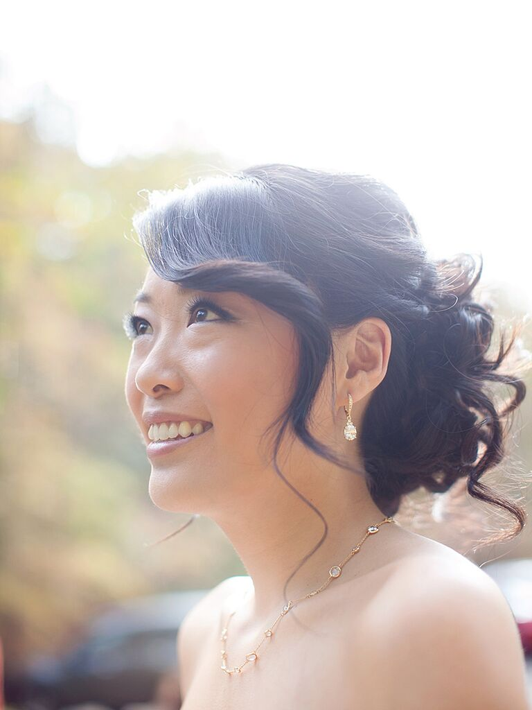 Messy pin-up bun wedding hairstyle