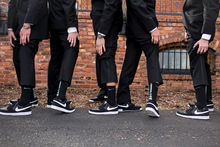 The men added a personal feel to their black tuxedos from Men's Wearhouse with black Nike shoes and matching Nike elite socks with a mint strip.rn