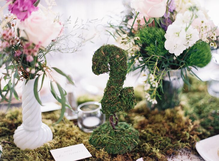 Moss table numbers helped create a gardenlike ambiance on the table settings.
