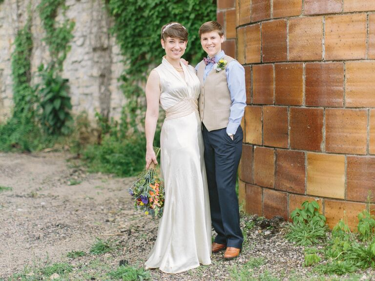 same sex couple in wedding dress and formal vest