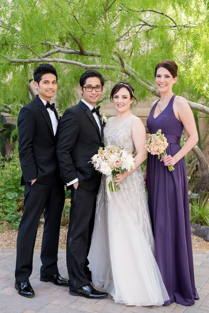 The only bridesmaid in the wedding party, Anna's best friend of over 20 years, wore a floor-length amethyst Vera Wang gown; the best man wore a tux with matching purple elements.
