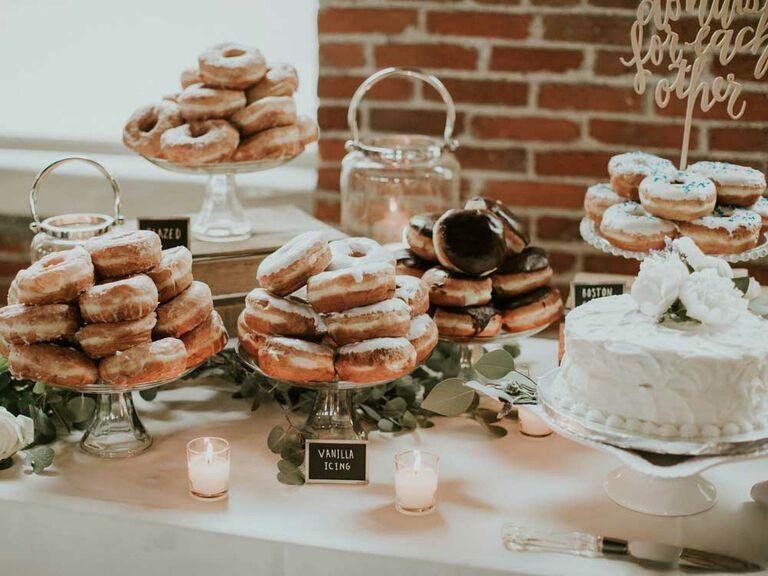 Assorted glazed donut spread at wedding