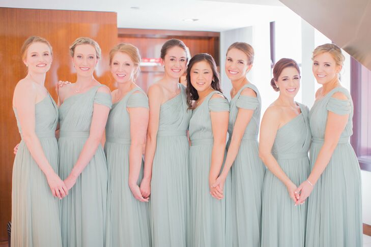 The eight bridesmaids wore one-shoulder Grecian-style light green J.Crew dresses. Monica thought the shade of green was not only beautiful but also perfect for creating a neutral background for flowers and decor.