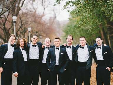 Groomsmen in black tuxedos and bow ties
