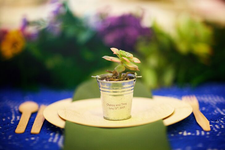 To express their love for plants and growing things, Chelcie and Troy sent guests home with baby succulents in little metal tin pails. Each pot had Chelcie and Troy's name, plus their wedding date, printed on the front. The plants were perfect for decorating each place setting as well.