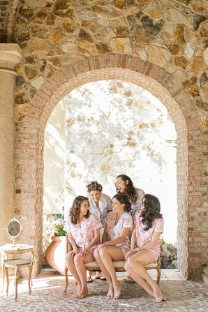 Bridesmaids Getting Ready under Tuscan Inspired Arch