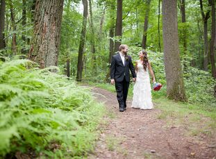 Lisa and Josh, loving the outdoors, had an intimate, outdoor ceremony full of woodland decor and touches of red and blue accents.