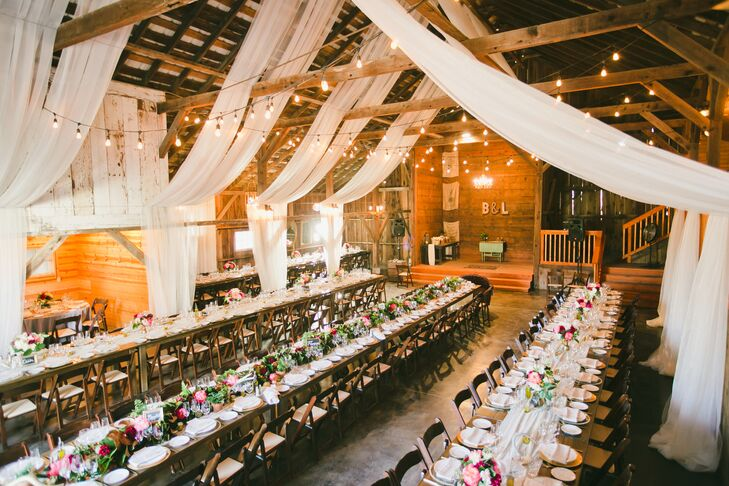 Inside the rustic barn at Olympia's Valley Estate in Petaluma, California, the high ceiling had wooden beams with white linens and string lights draped over the wooden dining tables. The reception decor truly fit the rustic-glam, romantic vibe that continued throughout the day.
