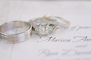 Silver Wedding Rings on a Wedding Invitation