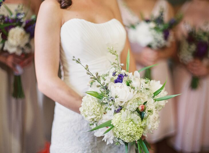 Ayse carried a purple and white bouquet of mixed seasonal blooms including white hydrangeas and baby's breath.