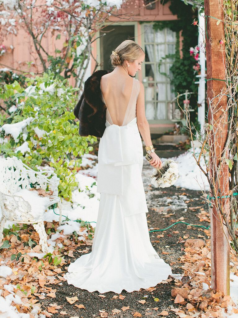 Backless wedding dress with tiered detailing