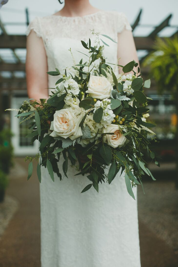 "A mix of ivory and white flowers, cascading greens and small berries made up Natalie's lush bouquet. ""I never thought I cared about flowers until I saw mine,"" she says. ""Money well spent."""