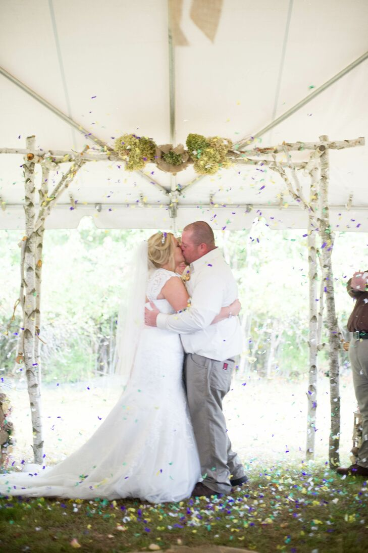 The couple exchanged vows beneath a birch tree arbor decorated with hydrangeas.