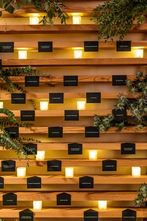 Modern Paper Escort Card Display with Candles and Greenery